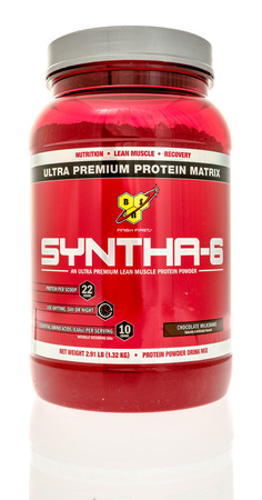 muscle gain: Winneconne, WI - 2 August 2016: Container of Syntha-6 protein powder in chocolate flavor on an isolated background.