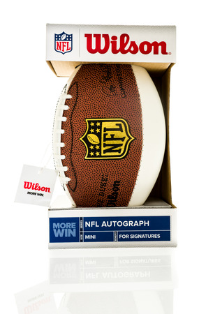 nfl football: Winneconne, WI - 1 August 2016: Wilson mini NFL football made for autographs on an isolated background.