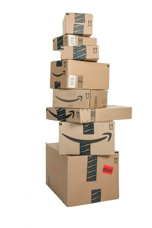 Winneconne, WI - 21 September 2016:  Bunch of Amazon boxes stacked on an isolated background. Reklamní fotografie - 64809272
