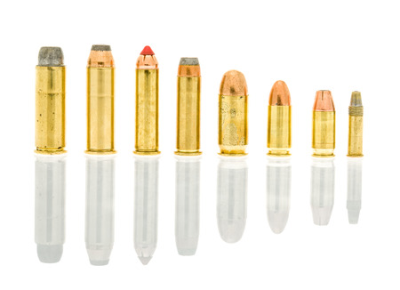 Hand gun caliber bullets on an isolated background including 45 long  , 44 rem mag, 357 mag, 38 special, 45 acp, 9 mm, 380 auto, 22