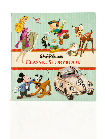 storybook: Winneconne, WI - 30 November 2016:  Walt Disney classic storybook containgin stories of classic Disney characters on an isolated background.