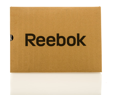 contains: Winneconne, WI - 8 December 2016:  Box that contains Reebox shoe, boots or clothing on an isolated background.