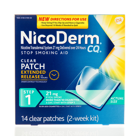 nicotine patch: Winneconne, WI - 13 December 2016:  Package of Nicoderm CQ stop smoking aid on an isolated background.