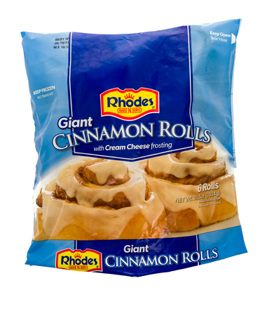 serv: Winneconne, WI - 22 December 2016: Bag of Rhodes giant cinnamon rolls with cream cheese frosting on an isolated background.