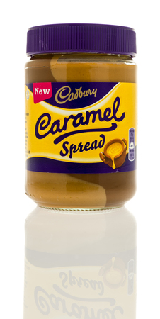 Winneconne, WI - 28 December 2016:  Container of Cadbury caramel spread on an isolated background. Editorial