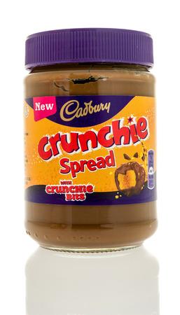 Winneconne, WI - 3 January 2017:  Jar of Cadbury crunchie spread on an isolated background.