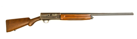 A vintage 12 gauge shotgun on an isolated background