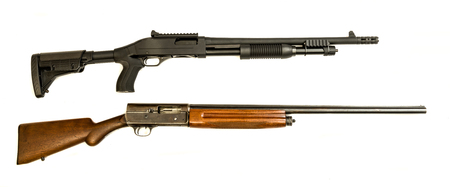 A vintage and modern tactical 12 gauge shotgun on an isolated background