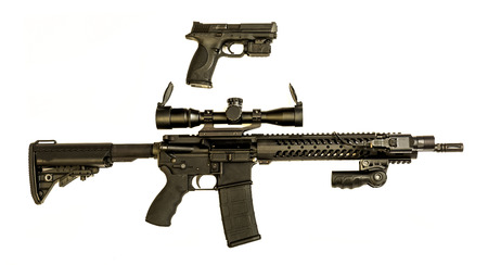 A modern semi auto hand pistol in 9mm and AR-15 rifle that is a good combination that swat personal would carry together. Stock Photo