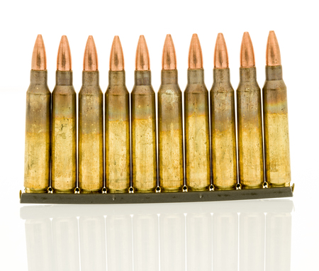 M16: Ammunition of 5.56mm NATO round on a standard military clip for faster loads into a magazine Stock Photo