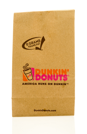 Winneconne, WI - 23 April 2017: A Dunkin Donuts paper bag on an isolated background. Editorial