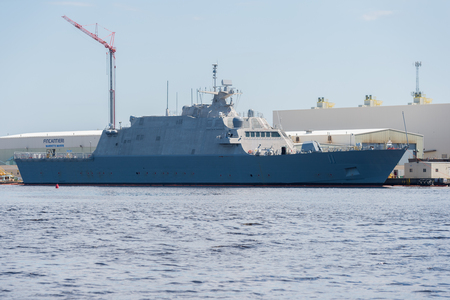 Marinette, WI - 12 May 2017:  A littoral US Navy ship sits at dock completing constuction.
