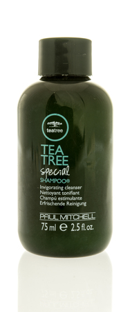 illustrative editorial: Winneconne, WI -13 June 2017: A bottle of Tea Tree special shampoo by Paul Mitchell on an isolated background Editorial