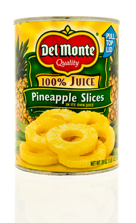 Winneconne, WI -16 June 2017: A can of Del Monte pineapple slices on an isolated background