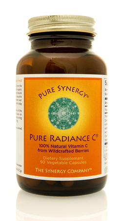 Winneconne, WI - 4 June 2017: A bottle of Pure Synergy radiance vitamin C capsules an isolated background