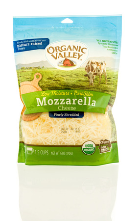 Winneconne, WI -22 June 2017: A bag of Organic Valley shredded mozzarella cheese on an isolated background