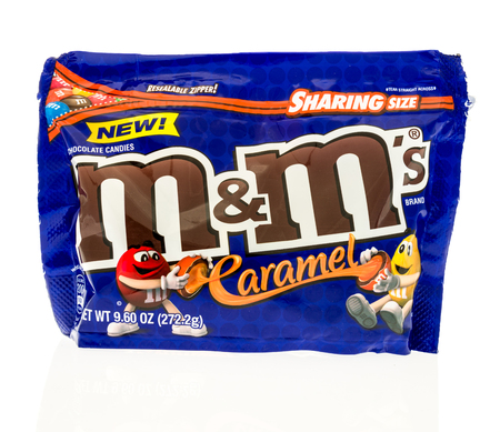 Winneconne, WI - 10 July 2017: A bag of M&Ms in caramel flavor on an isolated background.