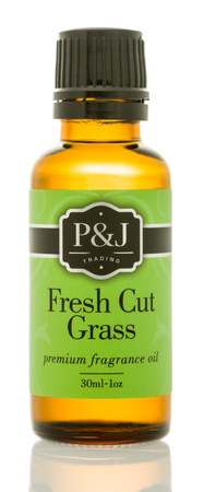 Winneconne, WI - 6 August 2017:  A bottle of P&J Trading fragrance oil in fresh cut grass scent on an isolated background. Stok Fotoğraf - 83452657