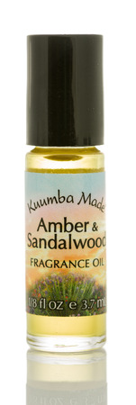 Winneconne, WI - 6 August 2017:  A bottle of Kuumba Made fragrance oil in amber and Sandalwood scent on an isolated background. Editorial