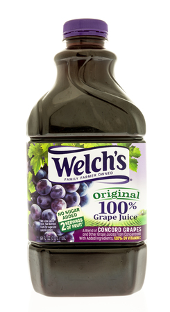 concord grape: Winneconne, WI - 14 August 2017:  A bottle of Welchs concord grape juice in on an isolated background Editorial