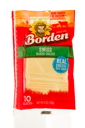 Winneconne, WI - 7 September 2017: A package of Borden swiss sliced cheese on an isolated background.