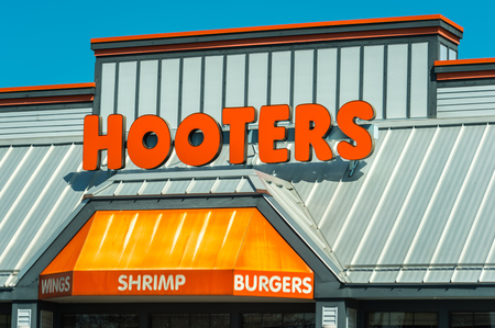 Madison, WI - 13 September 2017: Hooters restaurant sign. Editorial