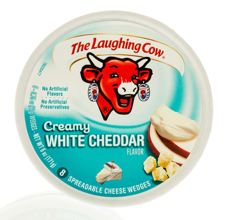 Winneconne, WI - 31 October 2017:  A package of The laughing cow in creamy white cheddar flavor on an isolated background.