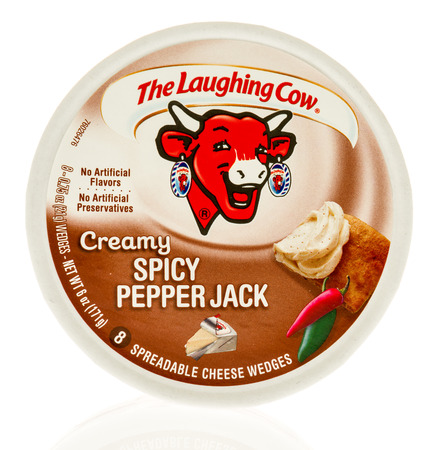 Winneconne, WI - 31 October 2017:  A package of The laughing cow in creamy spicy pepper jack flavor on an isolated background.
