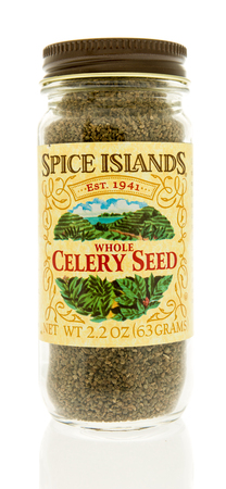Winneconne, WI - 31 October 2017:  A bottle of Spice Islands whole celery seed on an isolated background.