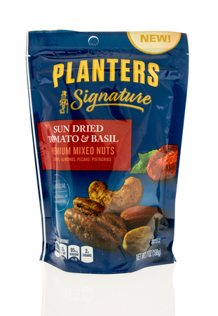 Winneconne, WI - 31 October 2017:  A container of Planters Signature sun dried tomato and basil mixed nuts  on an isolated background.
