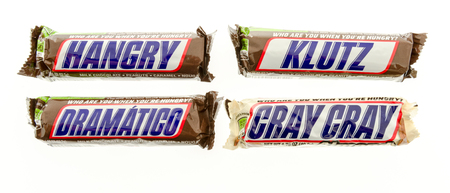 Winneconne, WI - 19 November 2017: Snicker candy bars with different names on them, such as hangry, klutz, gramaticgo and gray gray on an isolated background.
