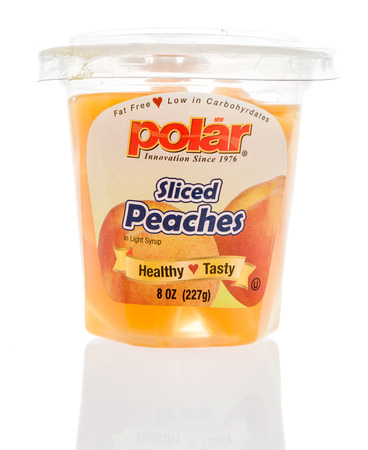 Winneconne, WI - 31 December 2017: A cup of Polar sliced peaches on an isolated background. Editorial