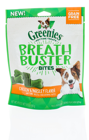 Winneconne, WI -6 January 2018: A bag of Greenies anytime breath buster bites dog treats on an isolated background.