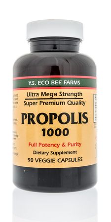Winneconne, WI - 10 January 2018: A bottle of Eco Bee Farms Propolis on an isolated background. Editorial