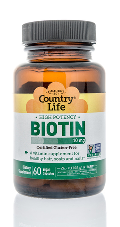 Winneconne, WI - 10 January 2018: A bottle of Country Life biotin on an isolated background.