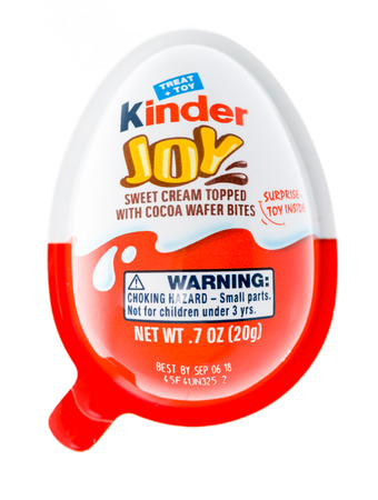 Winneconne, WI - 12 January 2018: A Kinder Joy egg with a suprise toy inside on an isolated background. Editorial