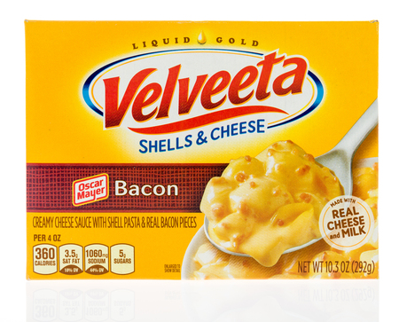 Winneconne, WI - 18 January 2018: A box of Velveeta shells and cheese with Oscar Mayer bacon on an isolated background. Editorial