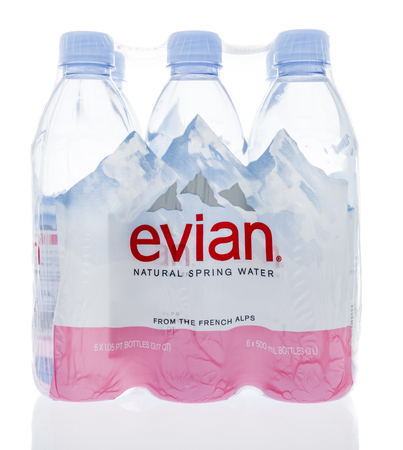Winneconne, WI - 18 January 2018: A six pack of Evian natural spring water on an isolated background.