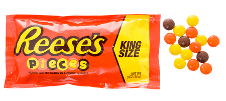 Winneconne, WI - 18 January 2018: A package of a King Size Reeses pieces on an isolated background.