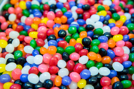 A close up shot of a lot of jelly beans in a large container Stock Photo