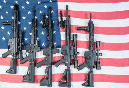 A collection of AR-15s on an American flag.