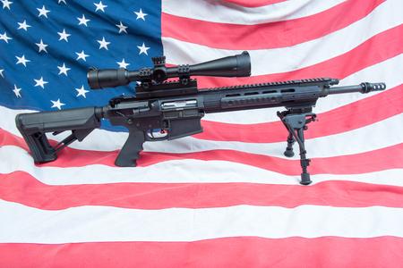 An AR-15 on an American flag