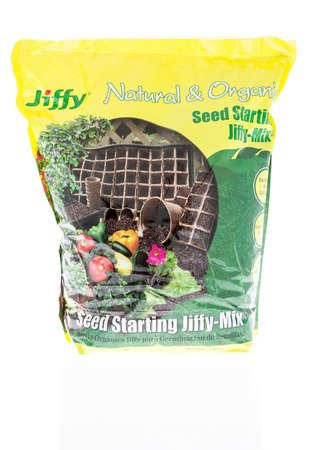 Winneconne, WI - 11 March 2018: A bag of Jiffy Natural and Organic seed starting mix on an isolated background. Stock Photo - 103414953