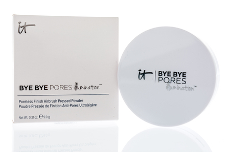 Winneconne, WI -  21 April 2018: A package of IT bye bye pores illumination pressed powder on an isolated background.
