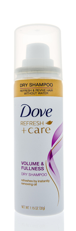 Winneconne, WI -  21 April 2018: A bottle of Dove refresh and care volume and fullness dry shampoo on an isolated background.