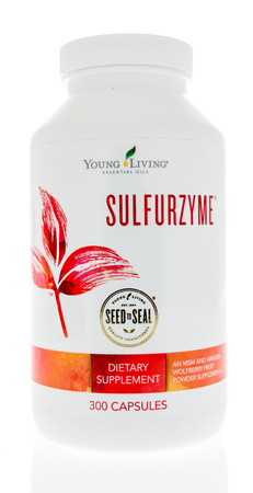 Winneconne - 24 May 2018: A bottle of Young Living Sulfurzyme supplement on an isolated background. Editorial