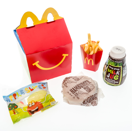 Winneconne, WI - 7 August 2018: A hamburger happy meal with chocolate milk  and apple slices on an isolated background