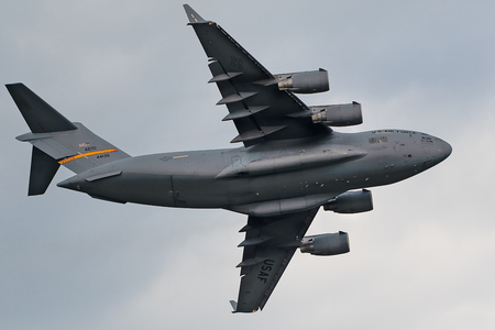 Oshkosh, WI - 28 July 2018:  A C-17 Globemaster with flying around at the EAA airshow.