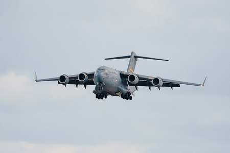 Oshkosh, WI - 28 July 2018:  A C-17 Globemaster with it's landing gear down at the EAA airshow. Sajtókép