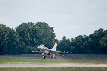 Oshkosh, WI - 28 July 2018:  A F-16 flying falcon is taking off at the EAA airshow. Editorial
